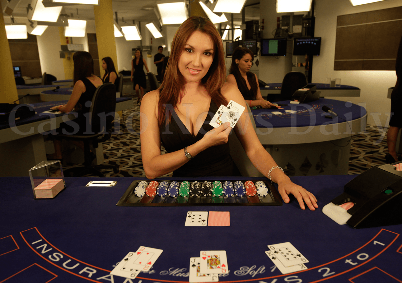 Blackjack dealer showing a AJ 21 hand.